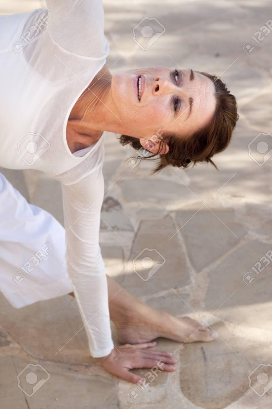 Happy woman doing advanced yoga Stock Photo - 17700427