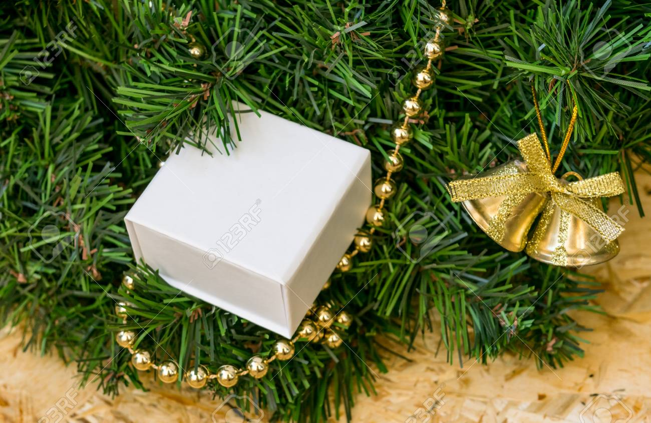 Artificial Christmas Tree Box.Artificial Christmas Tree Golden Beads And Bell A Gift In A