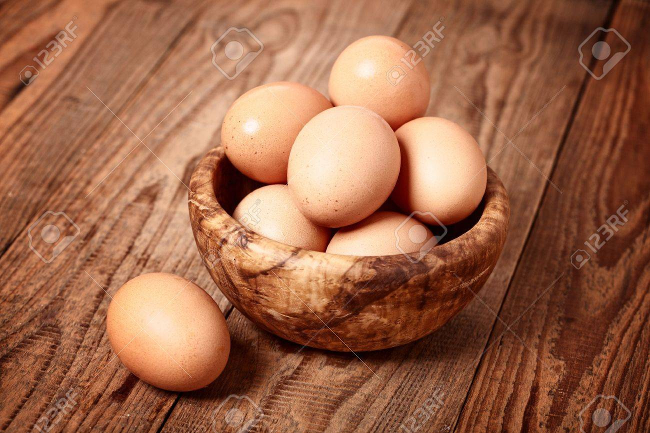 fresh brown eggs on wooden background Stock Photo - 11996711