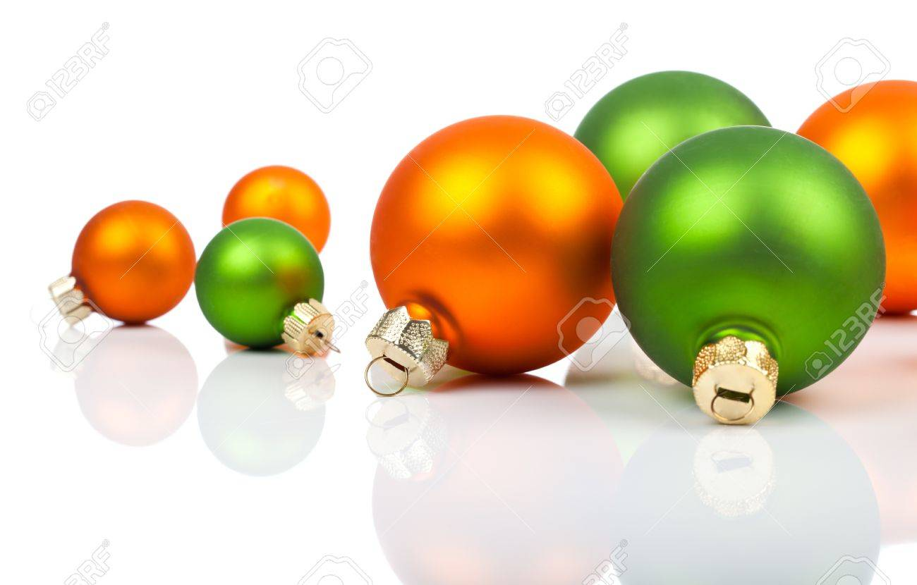 Multi Colored Christmas Ornaments Orange And Green On A White Background With Copy
