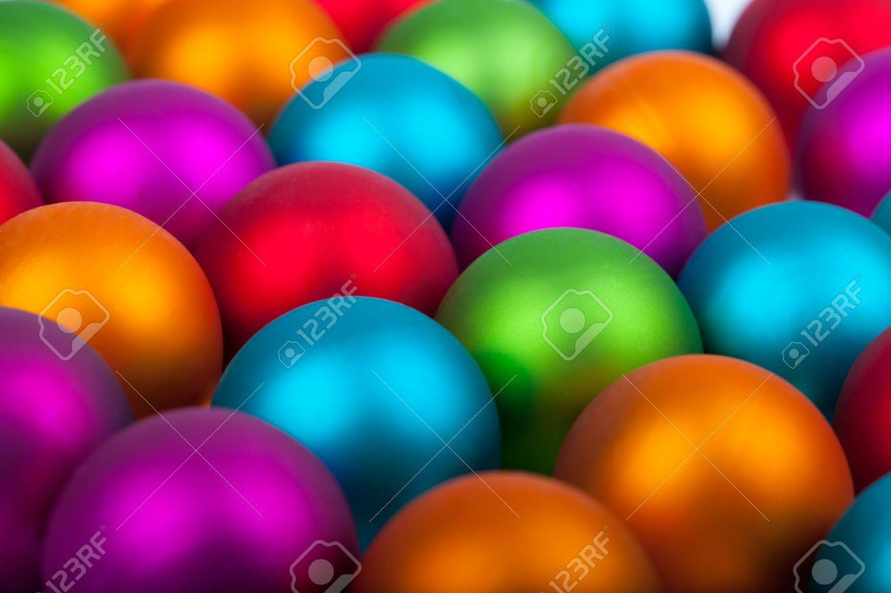 Multi-colored Christmas balls - red, orange, blue, purple and green as a background Stock Photo - 15778062