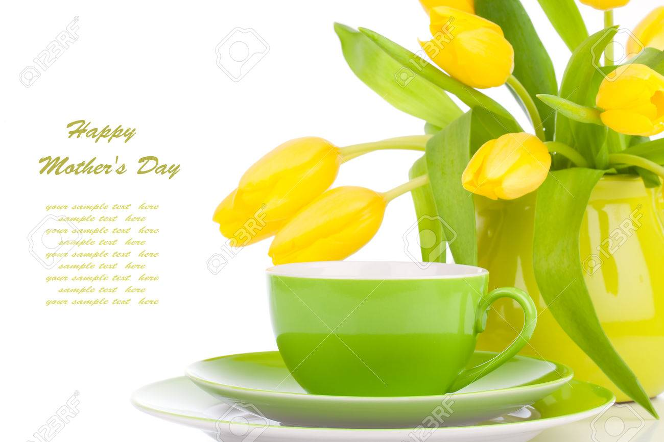 Yellow Tulips Flowers With Cup Tea On A White Background Stock