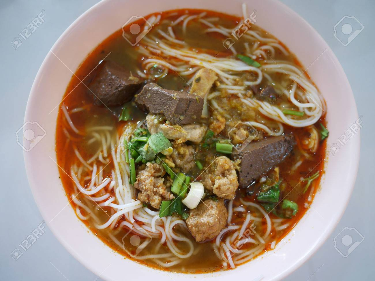 Rice noodles with spicy pork sauce, include Pork Chops, pork