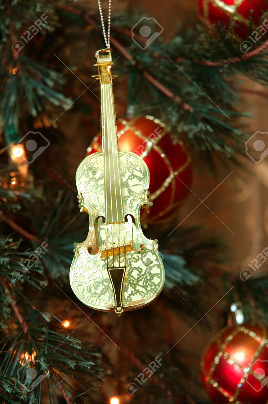 Violin christmas ornaments - Stock Photo Violin Shiny Gold Violin Ornament Hanging On A Christmas Tree