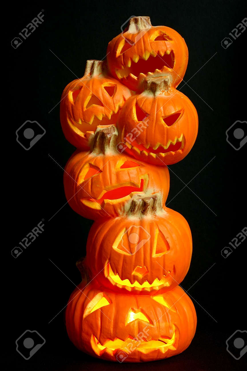 jack o lanterns halloween decoration a stack of pumpkins that have been carved into - Lighted Halloween Decorations