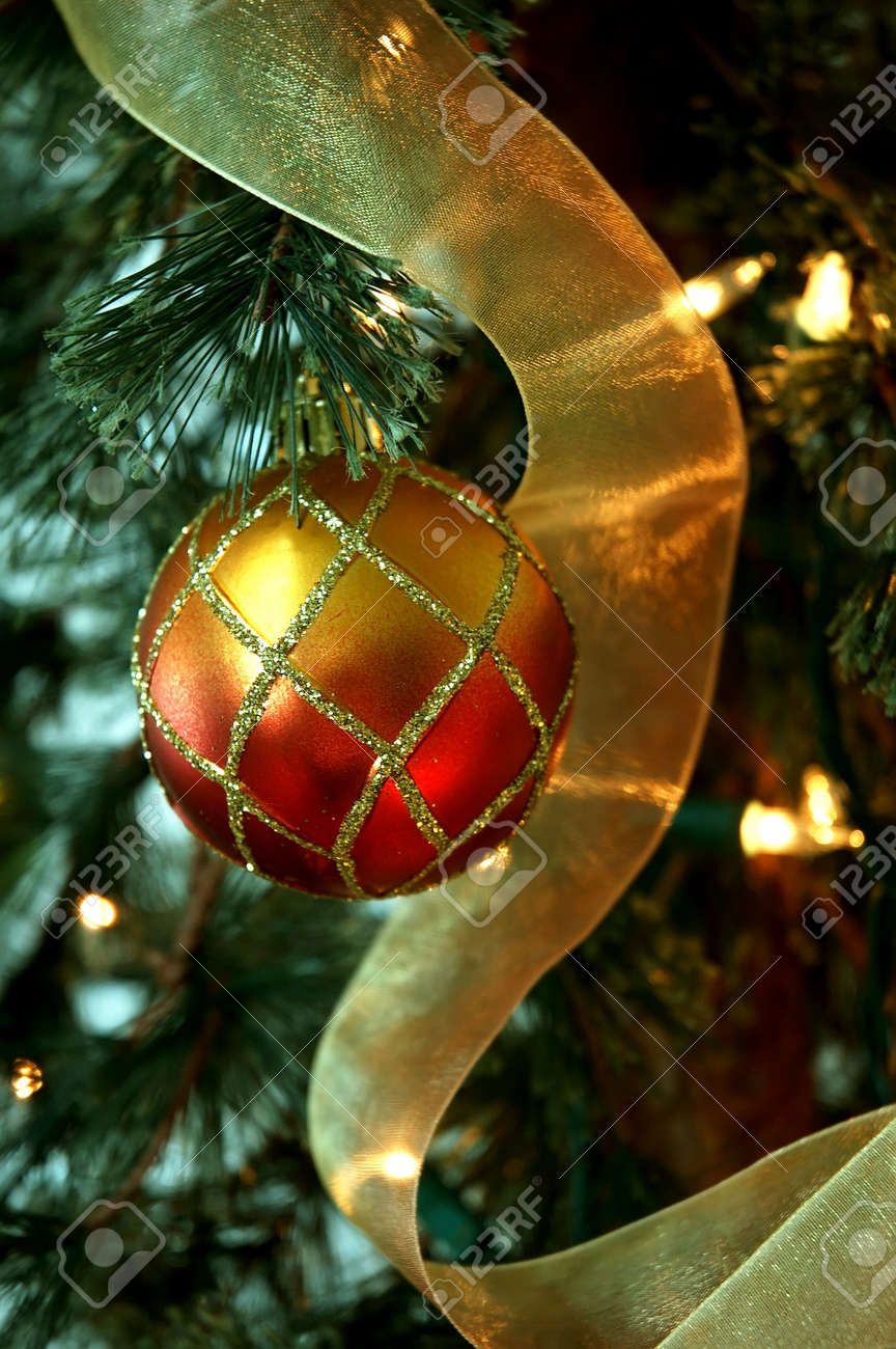 Christmas Tree Red And Gold Holiday Ornaments And Golden Ribbon