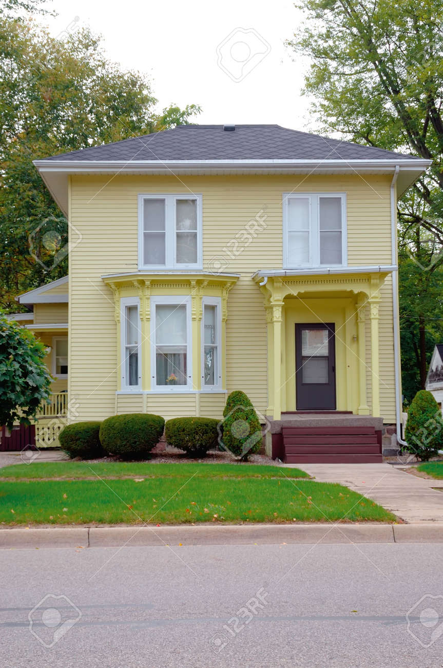 Yellow Victorian House A Yellow Wood Siding Victorian Style Stock Photo Picture And Royalty Free Image Image 548333