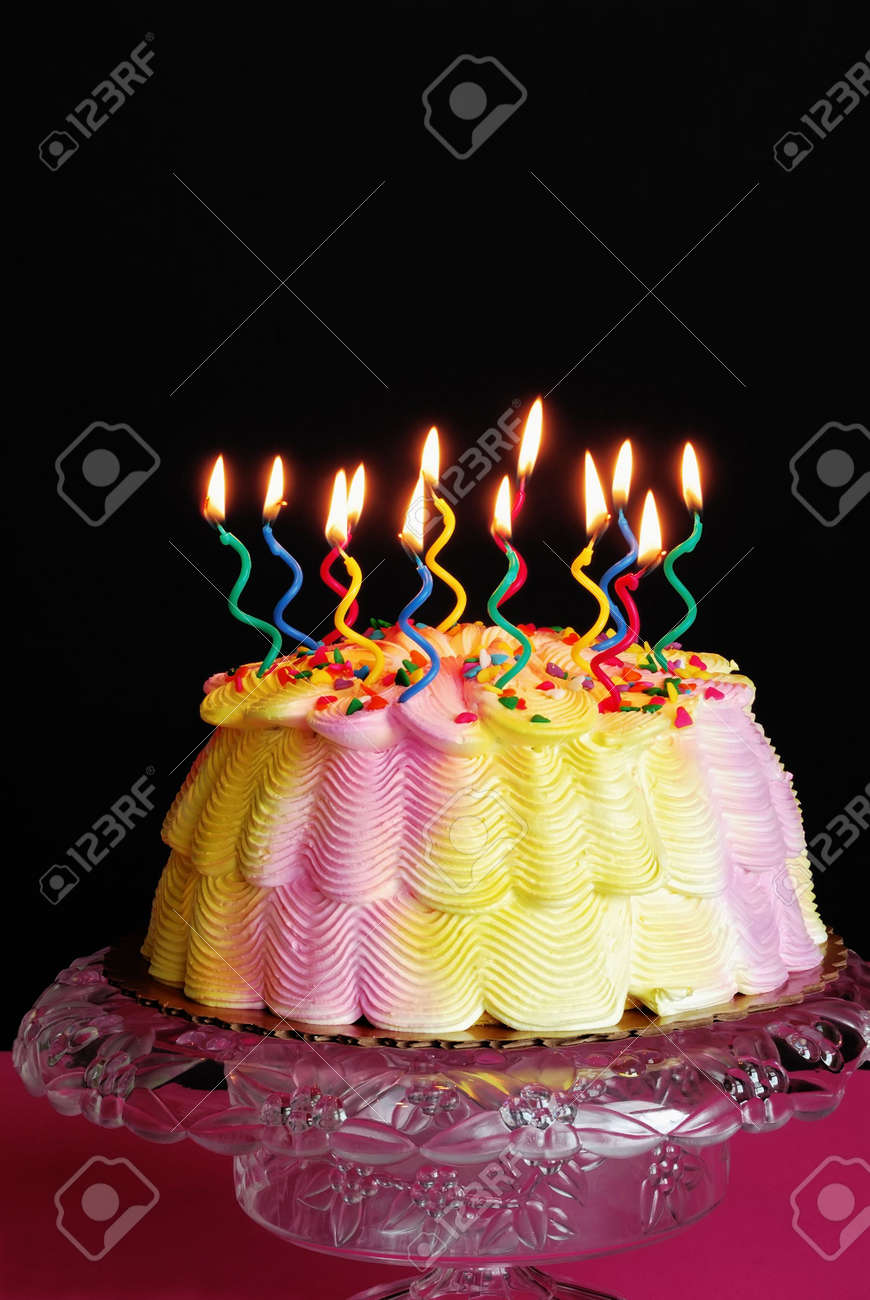 Astonishing Lighted Birthday Cake Lighted Candles On A Pink And Yellow Birthday Cards Printable Trancafe Filternl