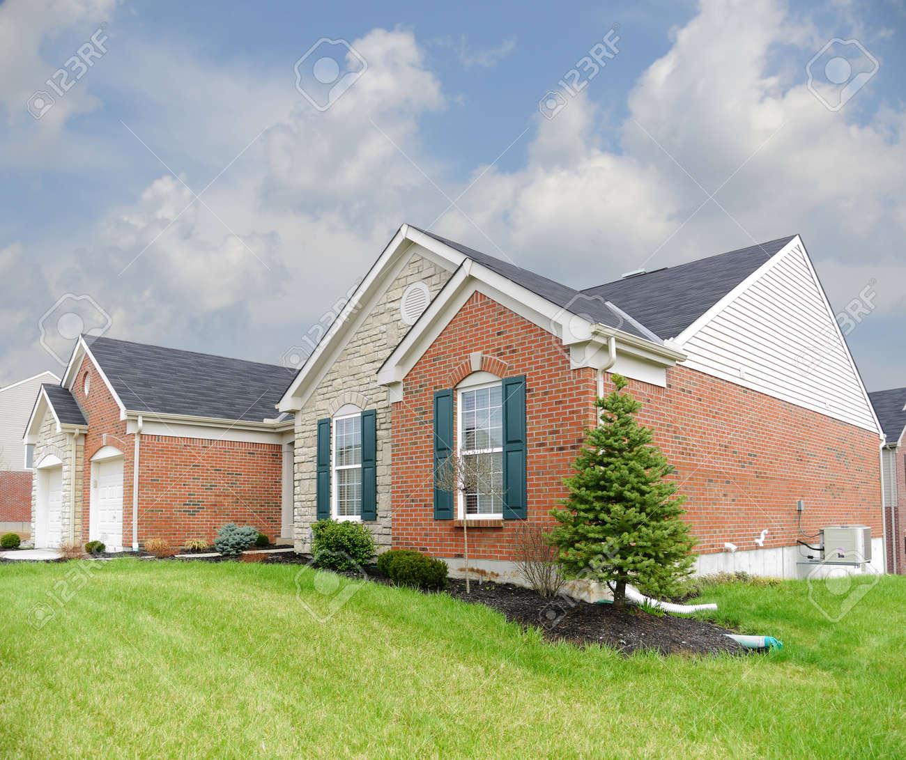 Suburban Neighborhood Brick and Stone Home - a spring day in the burbs. Stock Photo - 4541239