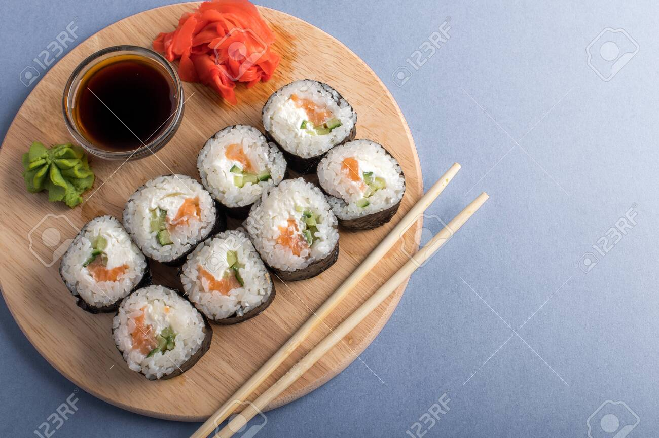Flat Lay With Sushi Rolls With Cucumber Cream Cheese And Raw Salmon Inside Tasty Japanese Seafood Restaurant Concept Blue Background Fotos Retratos Imagenes Y Fotografia De Archivo Libres De Derecho Image 148635203