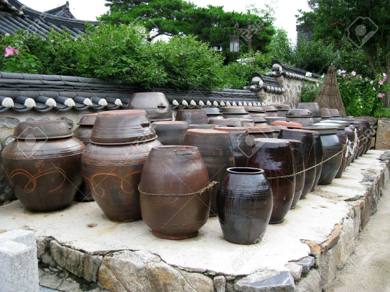 a lot of kimchi pot at the backyard of a heritage  in korea Stock Photo - 3404137