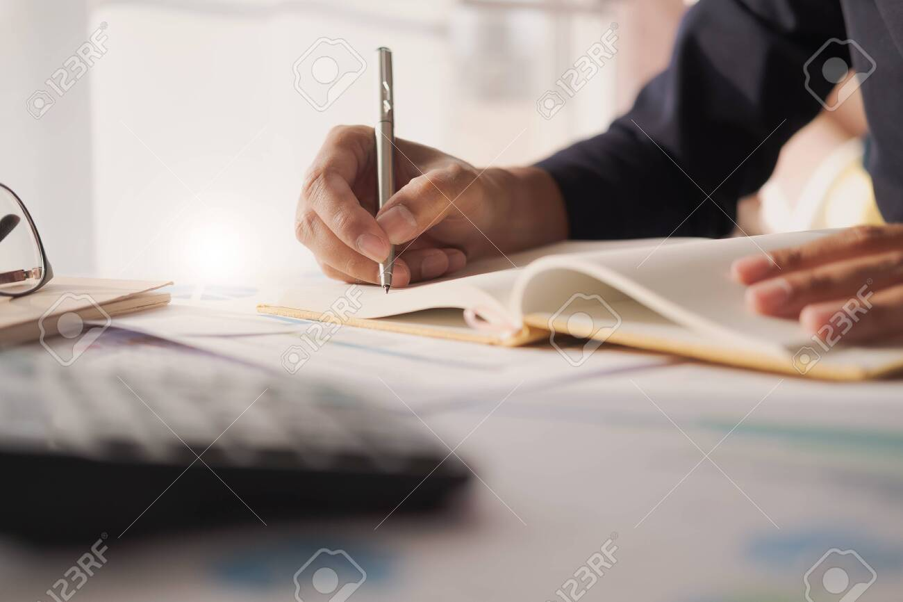 Close up view of bookkeeper or financial inspector hands making report, calculating or checking balance. Home finances, investment, economy, saving money or insurance concept - 145309267