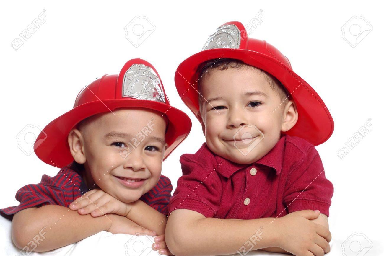 Two Preschool Boys Wearing Firefighter Hats Stock Photo - 579082
