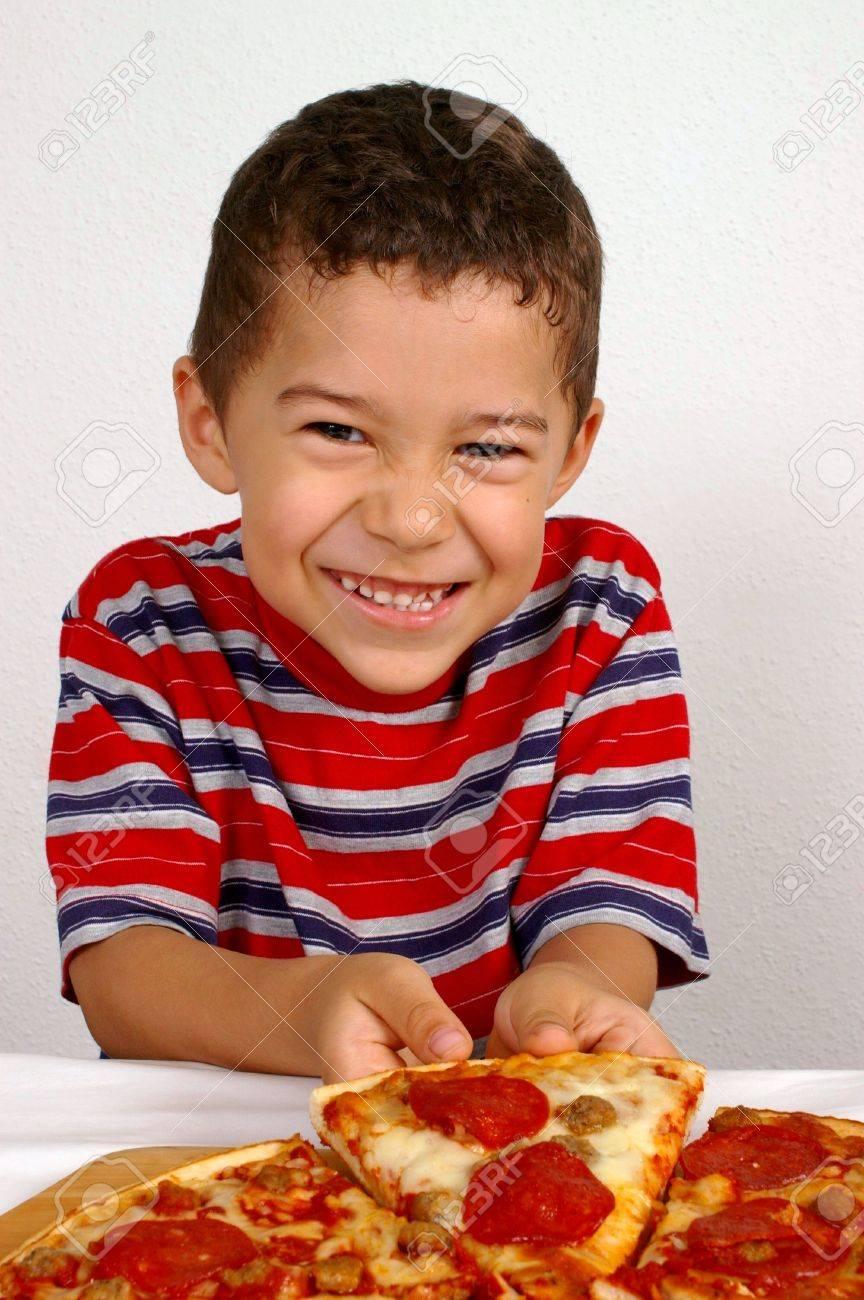 Boy ready to eat a pepperoni pizza Stock Photo - 2169580