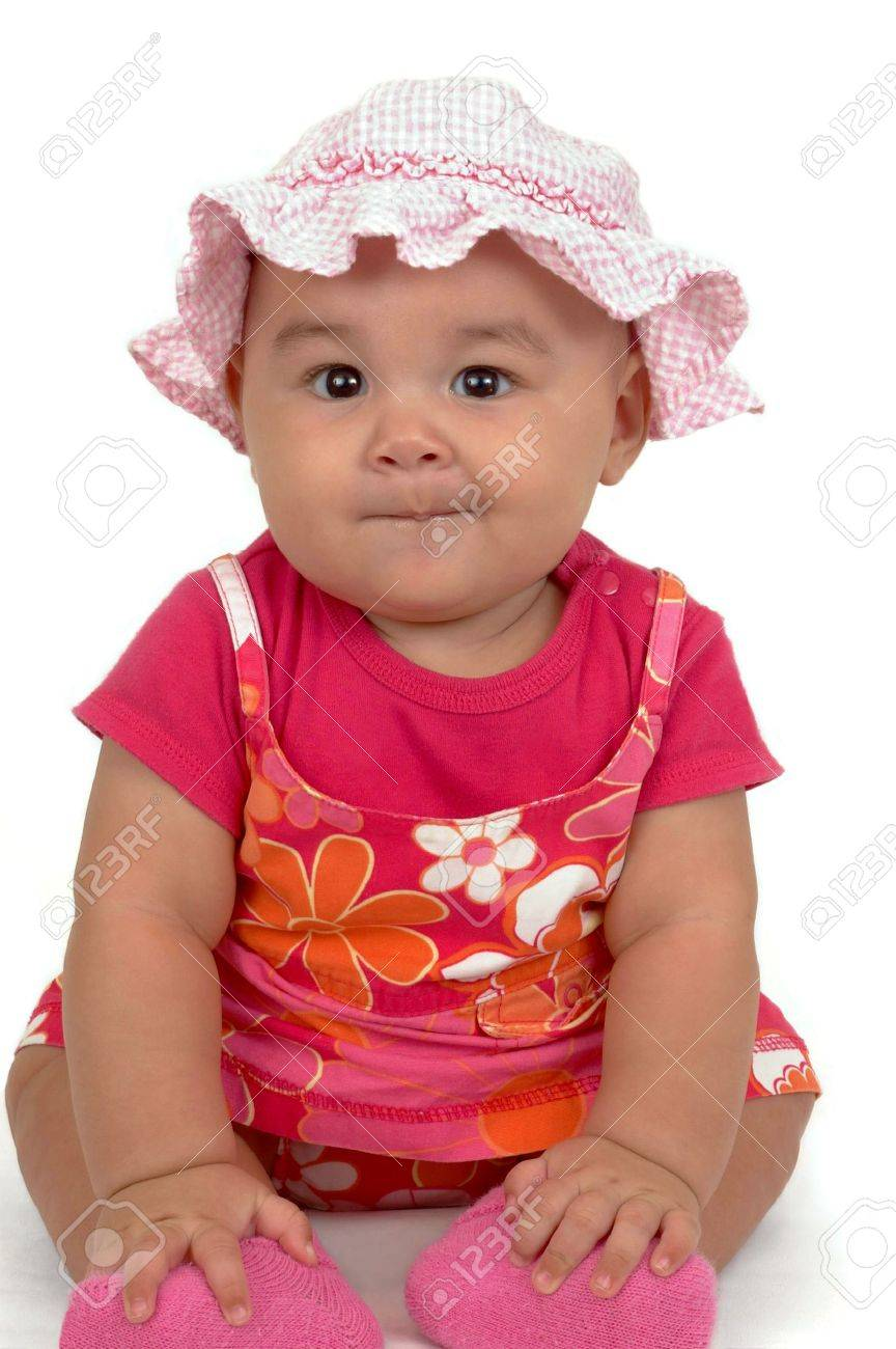 fea657e96 Baby Girl Wearing A Pink Jumper Outfit And Checkered Hat Stock Photo ...