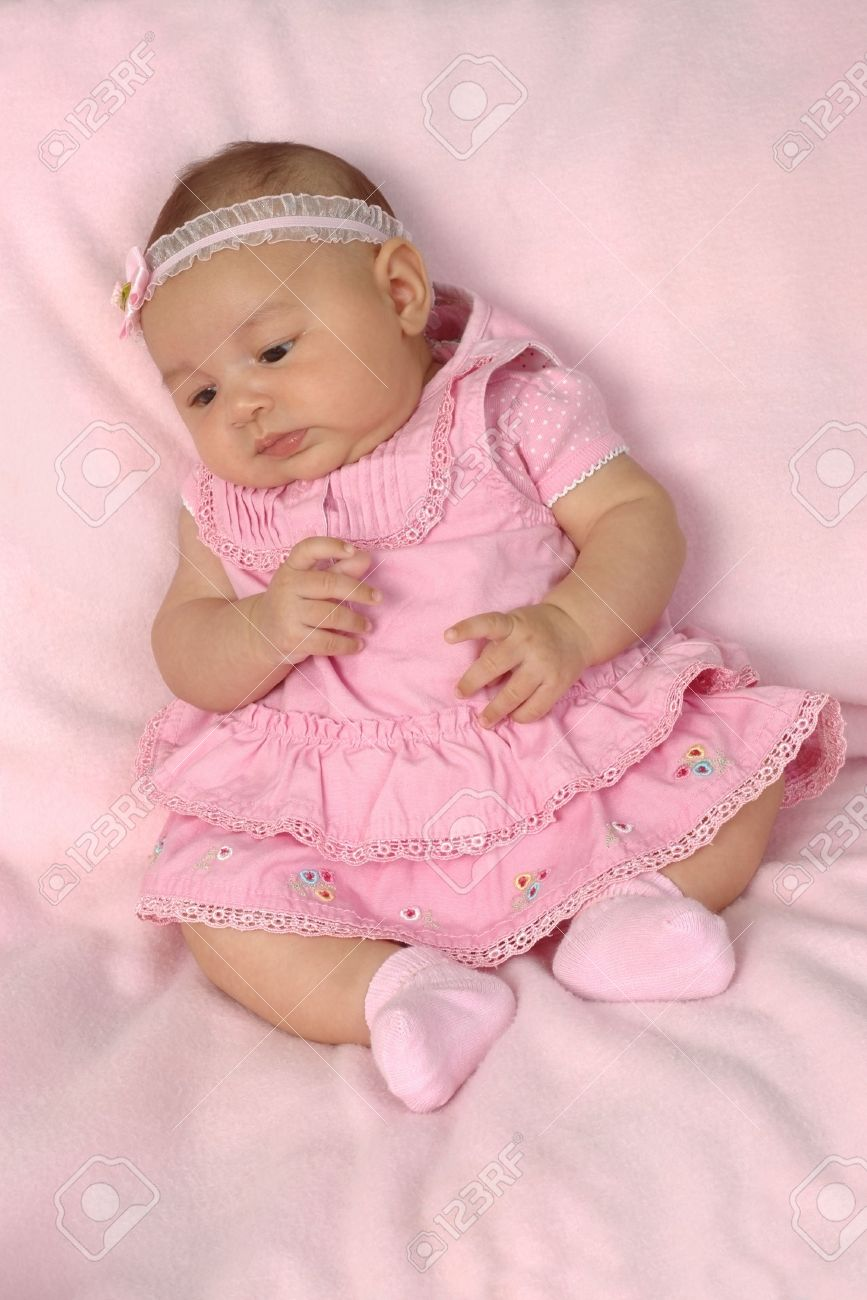 c423e3ae1 A 3-month-old Baby Girl In A Pink Dress Stock Photo