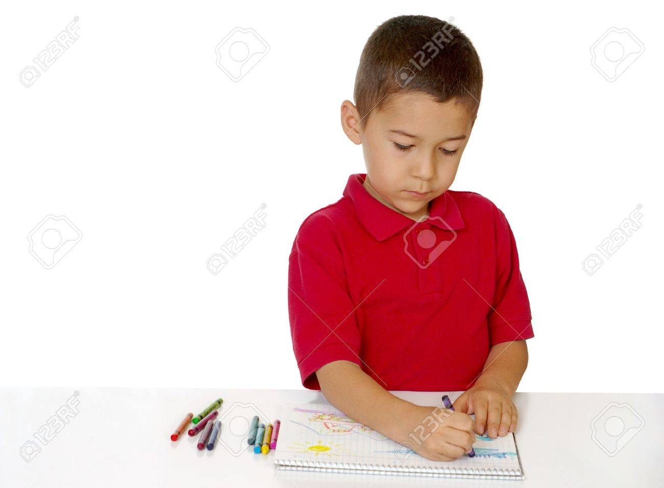 Seven Year Old Boy Coloring With Crayons Stock Photo