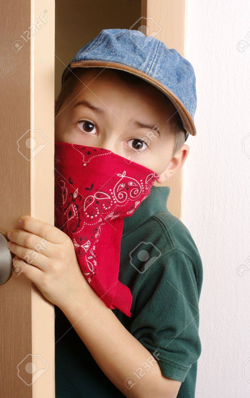 Boy sneaking through door Stock Photo - 6838218