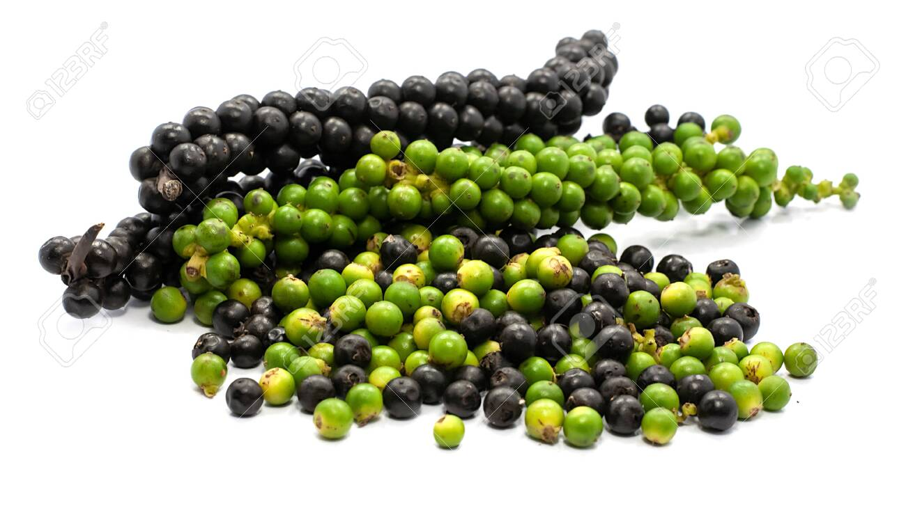 Fresh Green and black peppercorn isolated on white background - 136070414