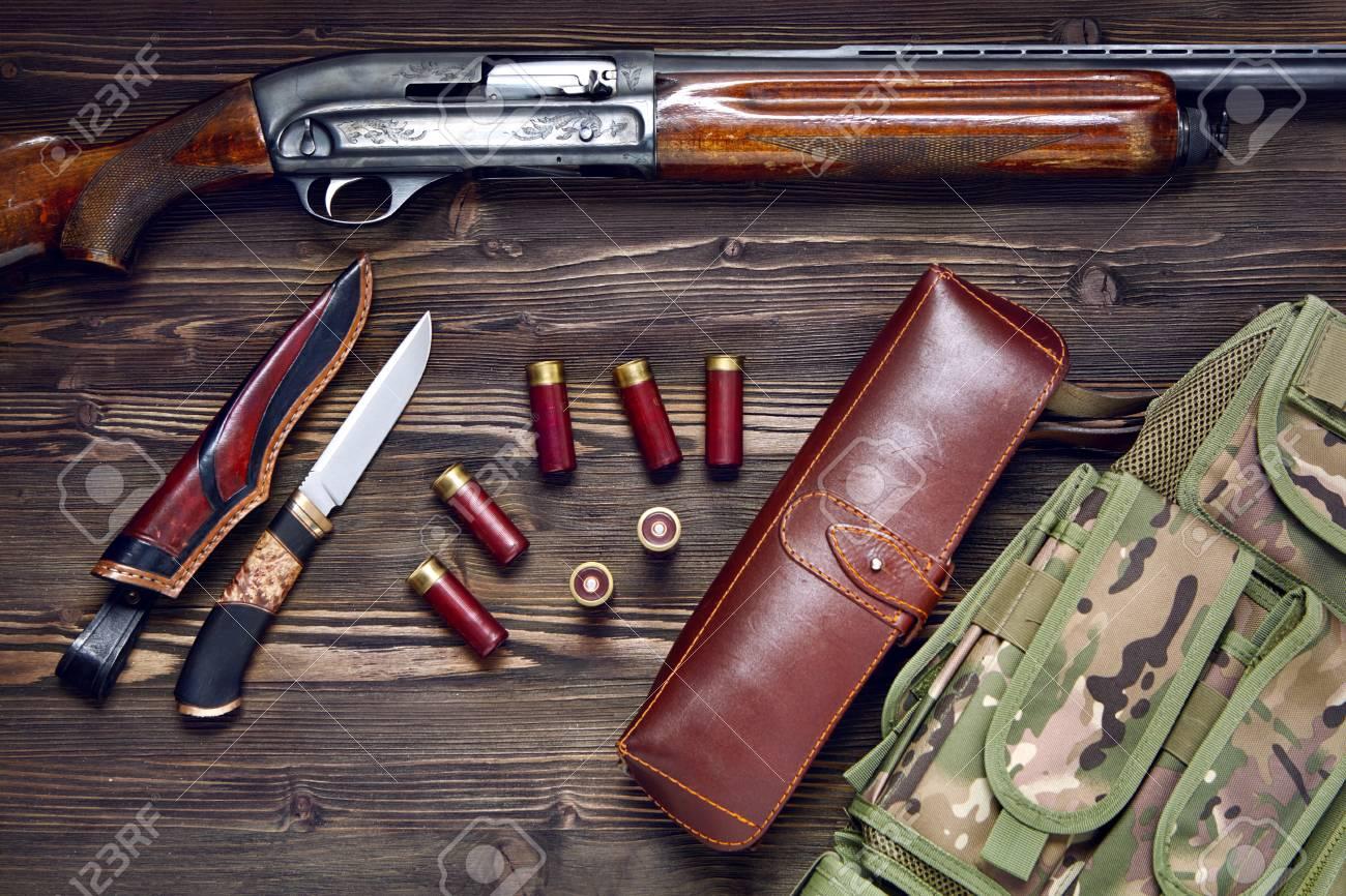 Lovačko oružje i municija - Page 4 97021267-hunting-rifle-and-ammunition-on-a-dark-wooden-background-top-view-