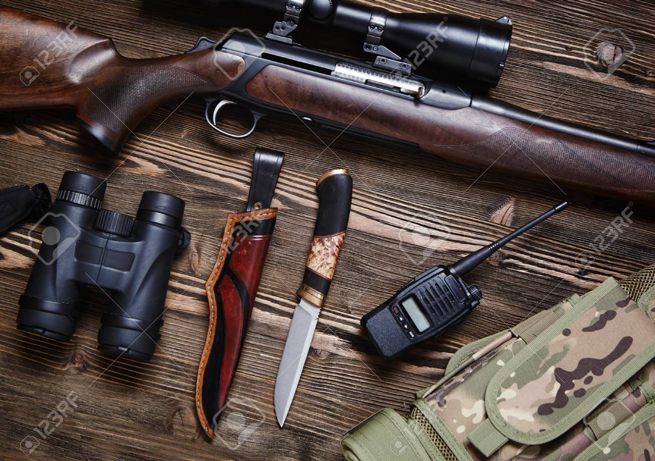 Lovačko oružje i municija - Page 4 97883014-hunting-rifle-and-ammunition-on-a-dark-wooden-background-top-view-