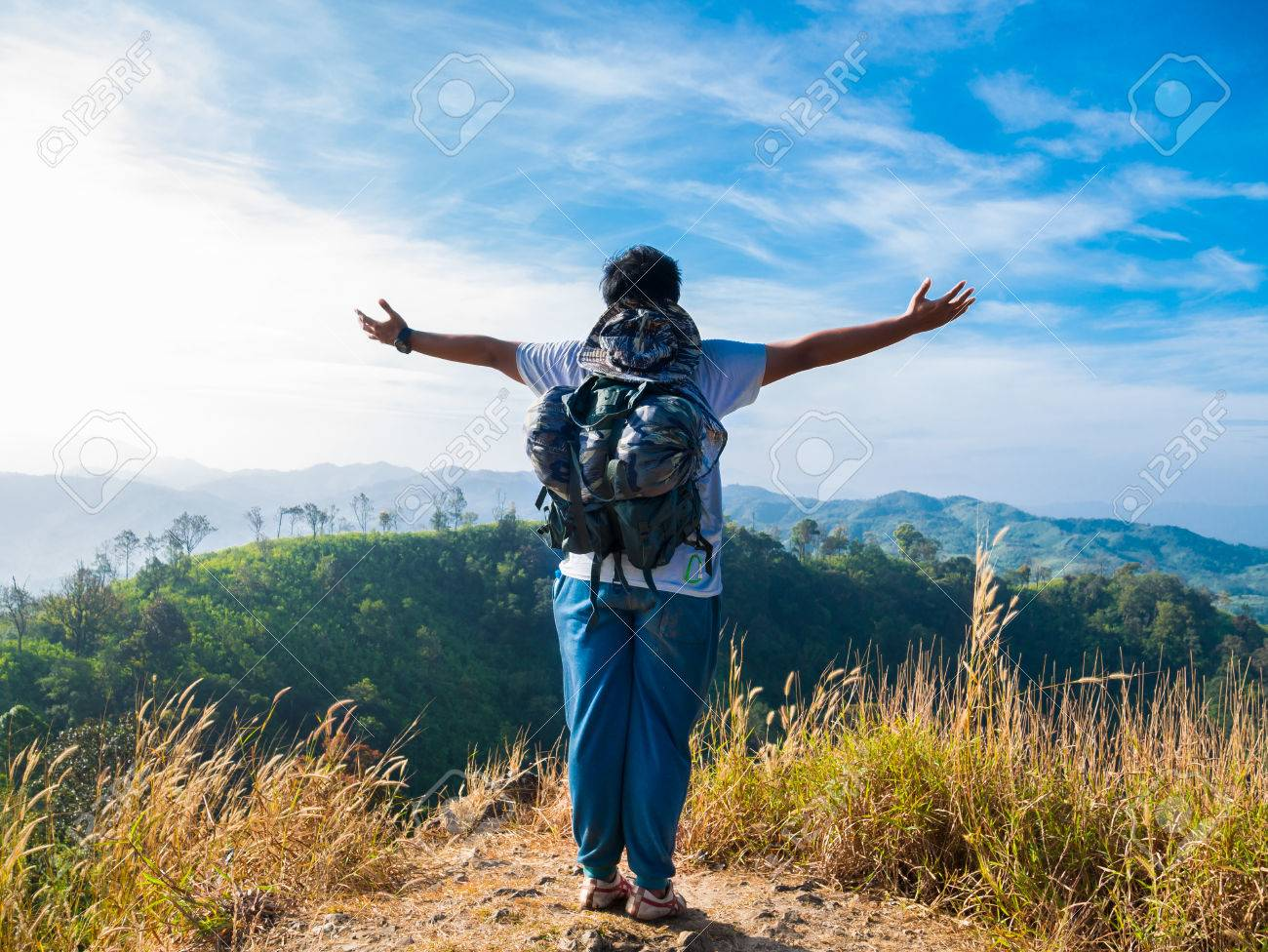 Asian man enjoy the freedom in valley Stock Photo - 26492663
