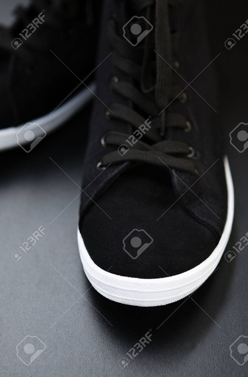 Black Laces And White Rubber Sole Foot