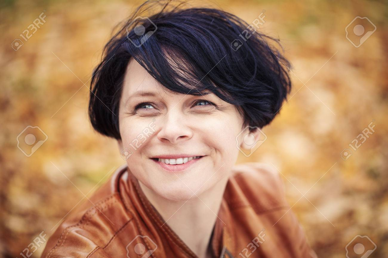 Closeup Portrait Of Middle Aged Caucasian Dark Haired Brunette