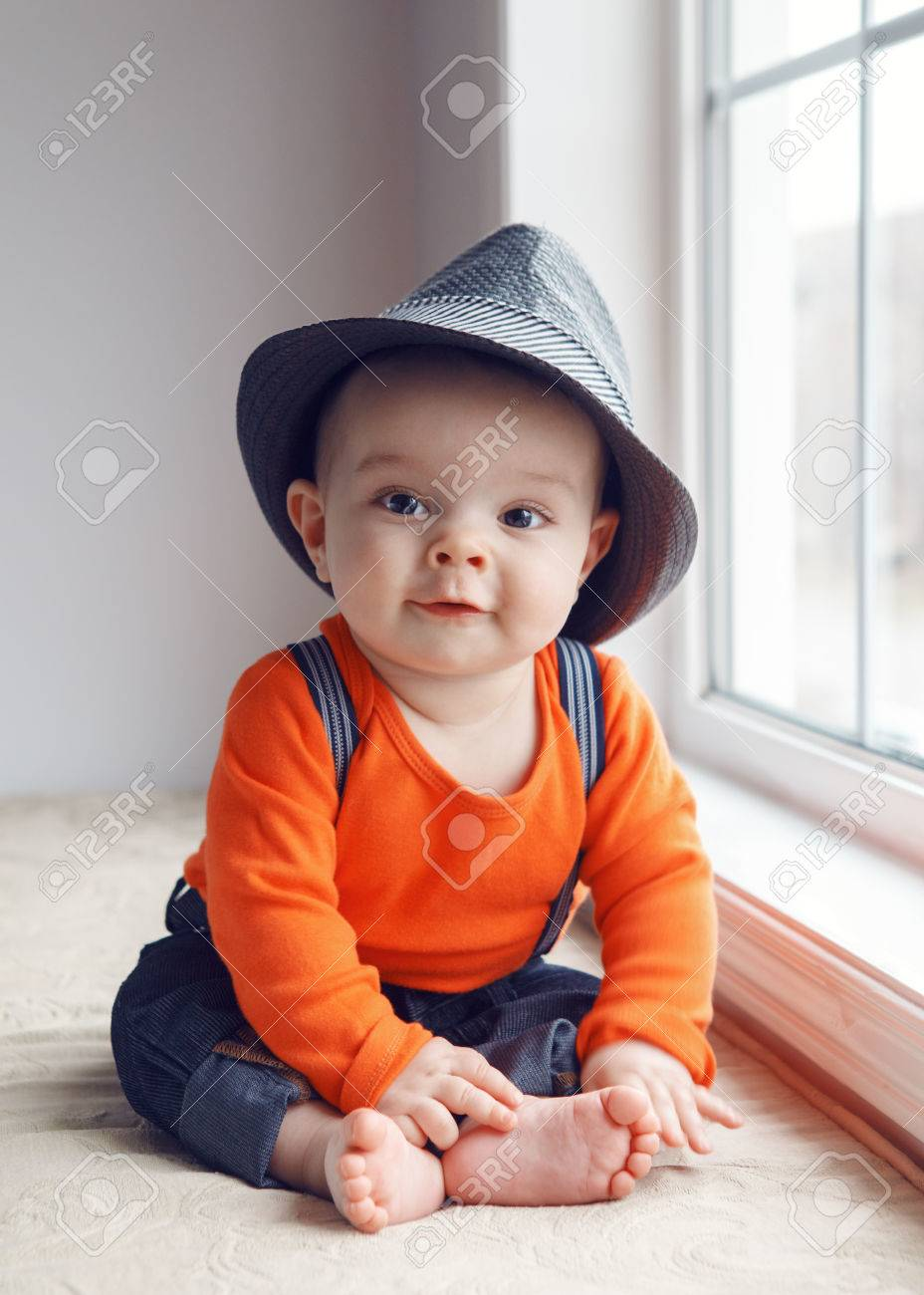 e210844c3e13 Portrait of cute adorable stylish Caucasian baby boy with black eyes in  hat