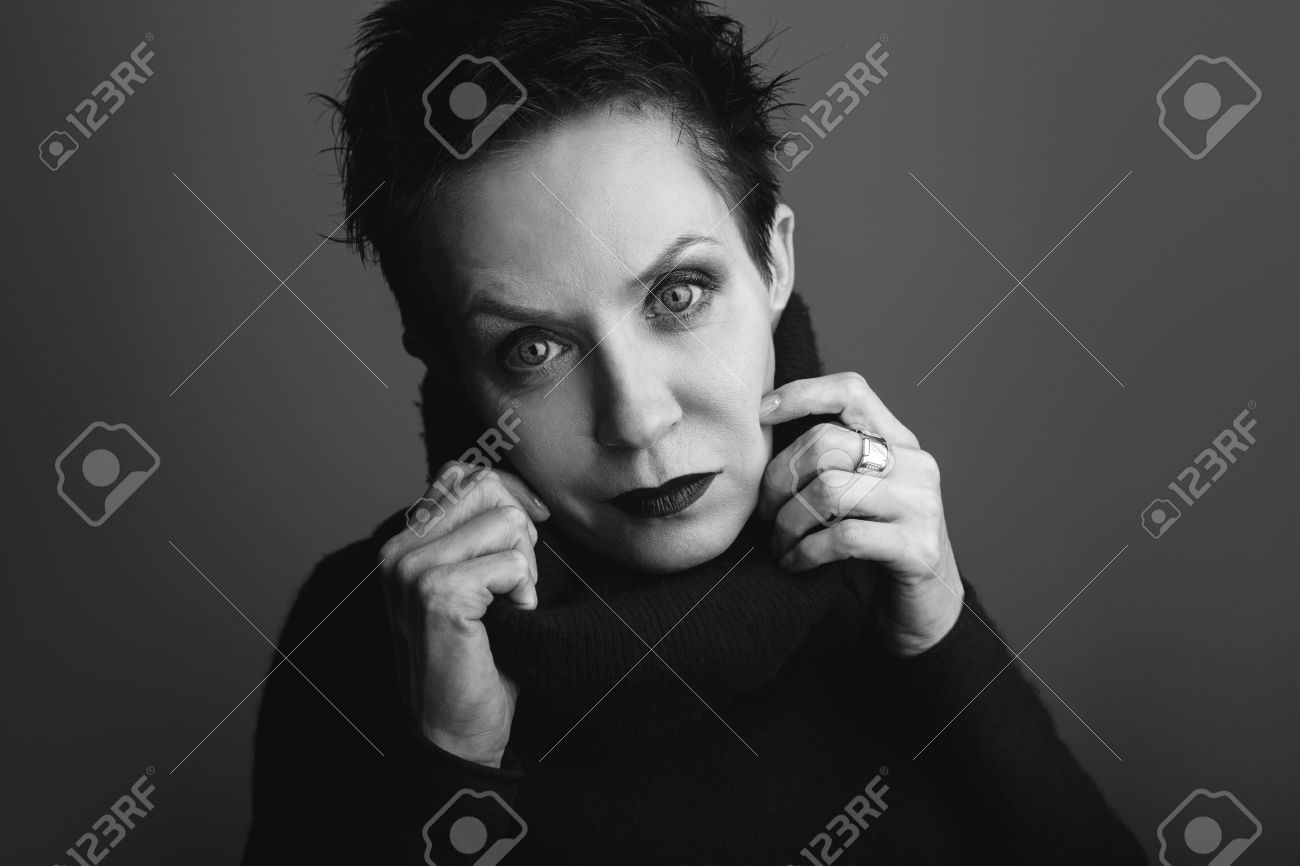 Studio black and white portrait of beautiful cool edgy middle