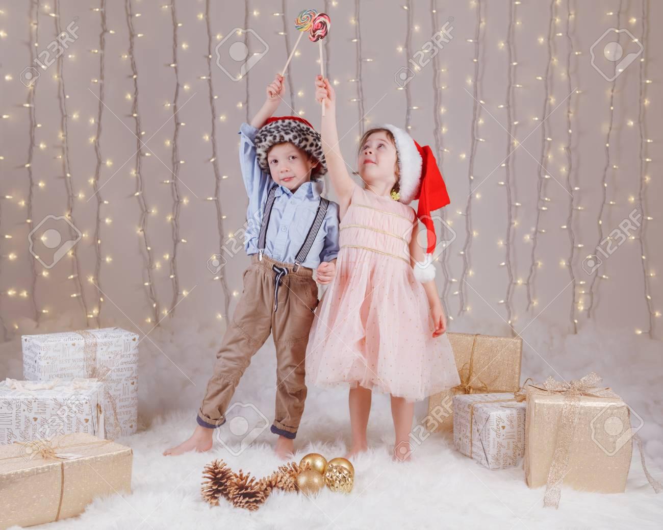 af94ea1073de0 Portrait of white Caucasian children friends wearing Santa Claus hats