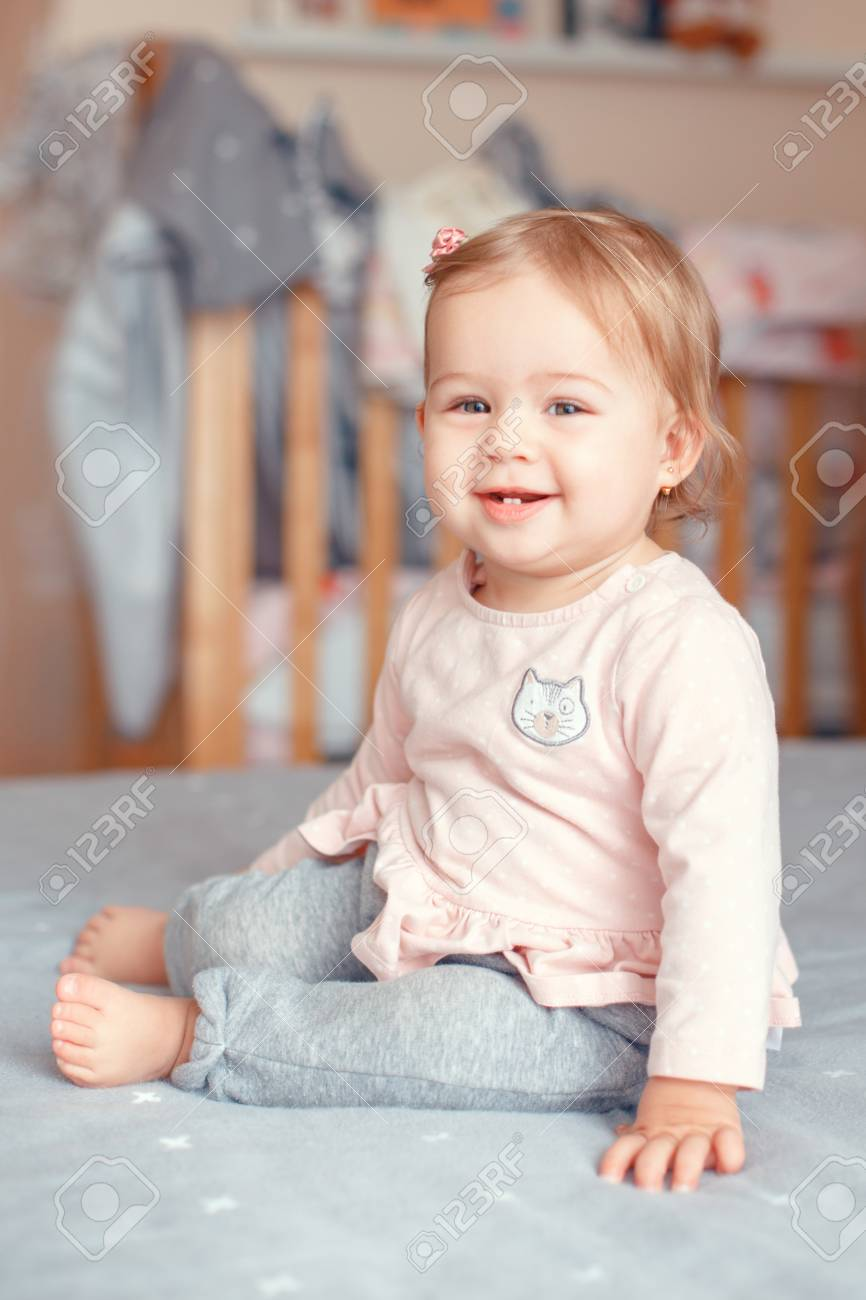 Portrait Of Cute Adorable Caucasian Blonde Smiling Baby Girl Stock Photo Picture And Royalty Free Image Image 94659054