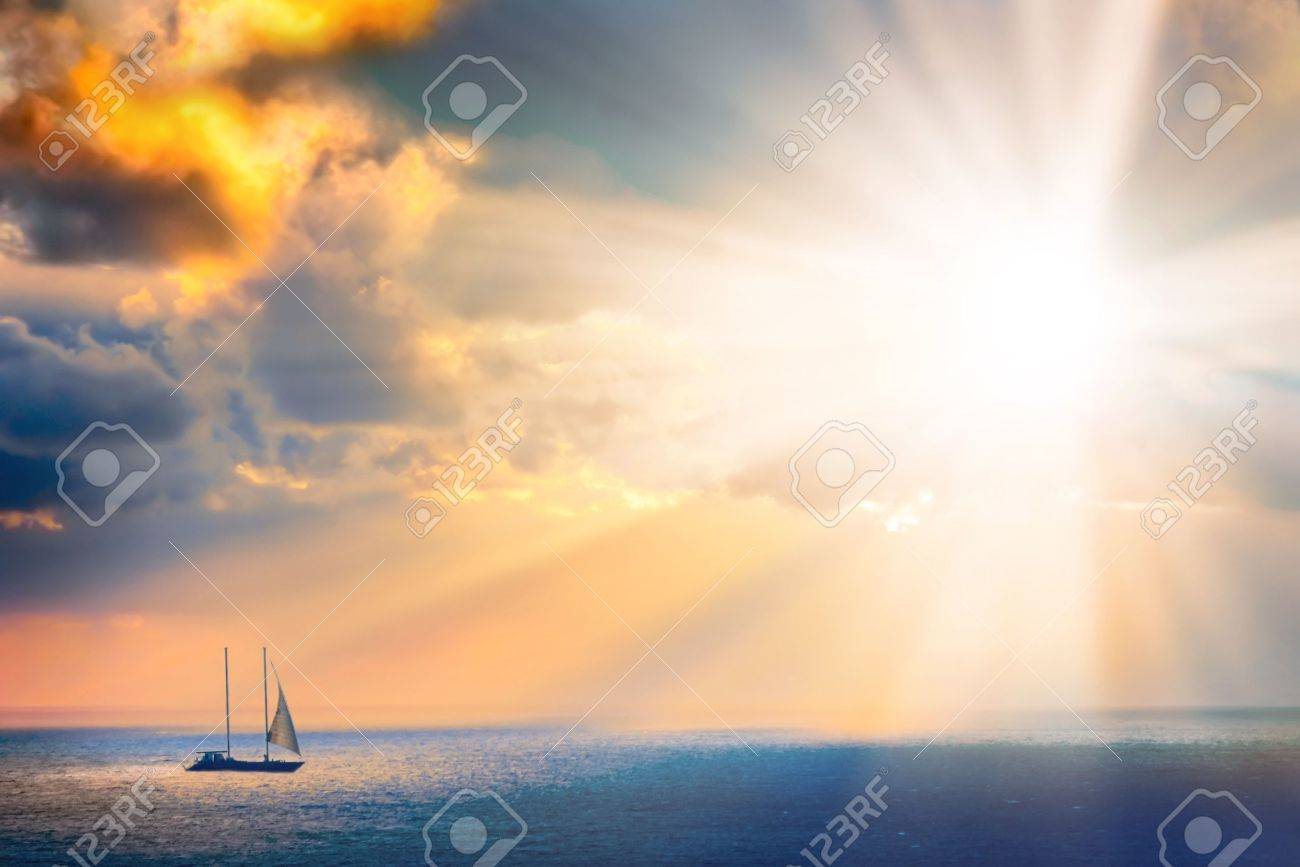 Through clouds on the sea light flows Stock Photo - 1797501
