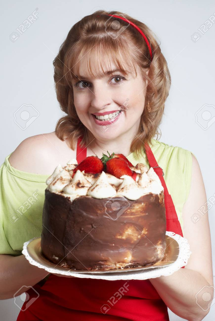 The beautiful women with a pie in hands Stock Photo - 5469053