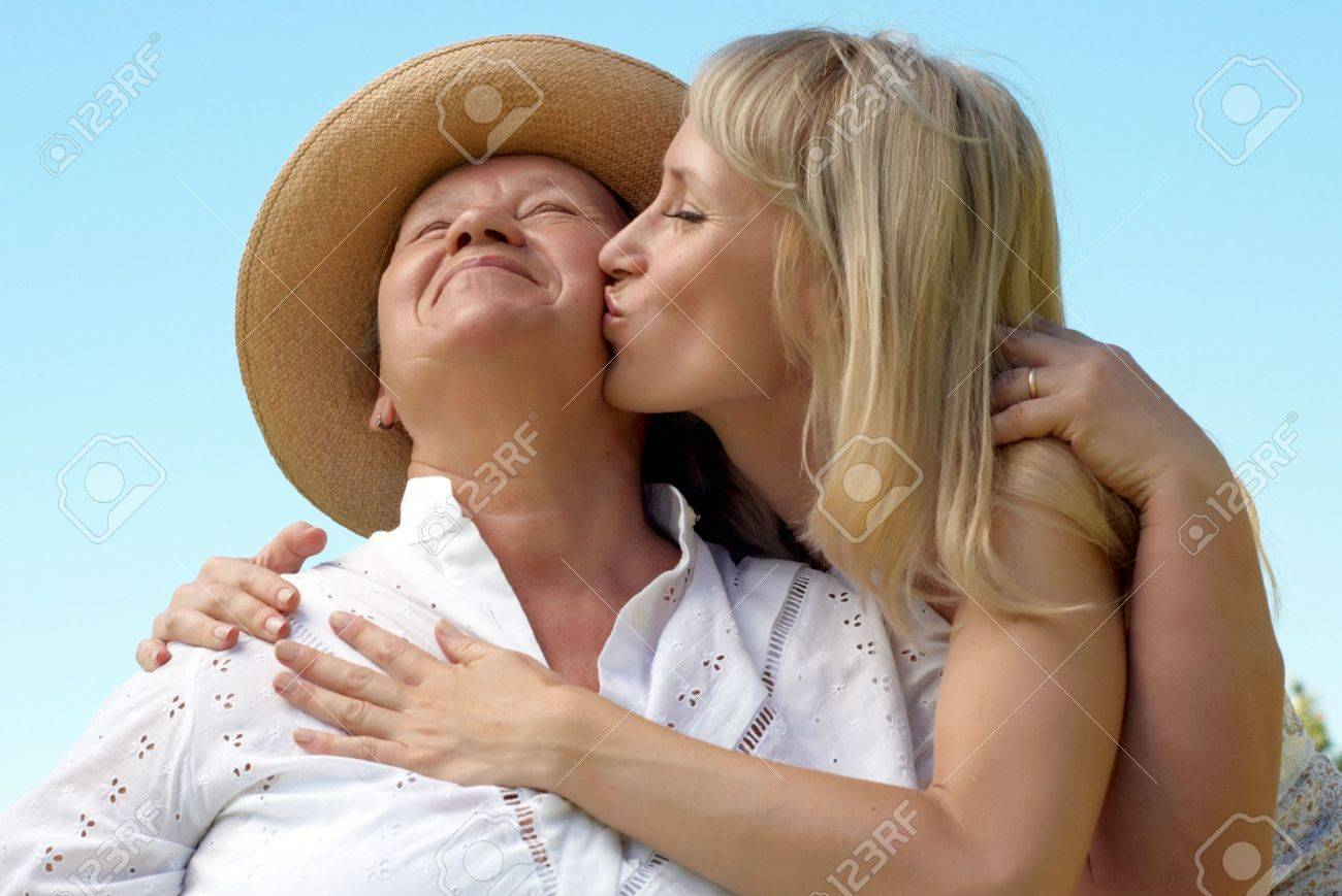 The daughter kissing  mother outdoors Stock Photo - 5482348