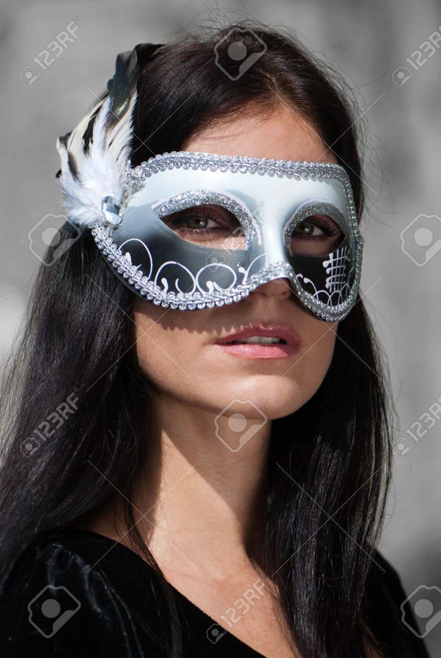 Portrait beautiful woman in black dress wearing carnival mask Stock Photo - 7953215