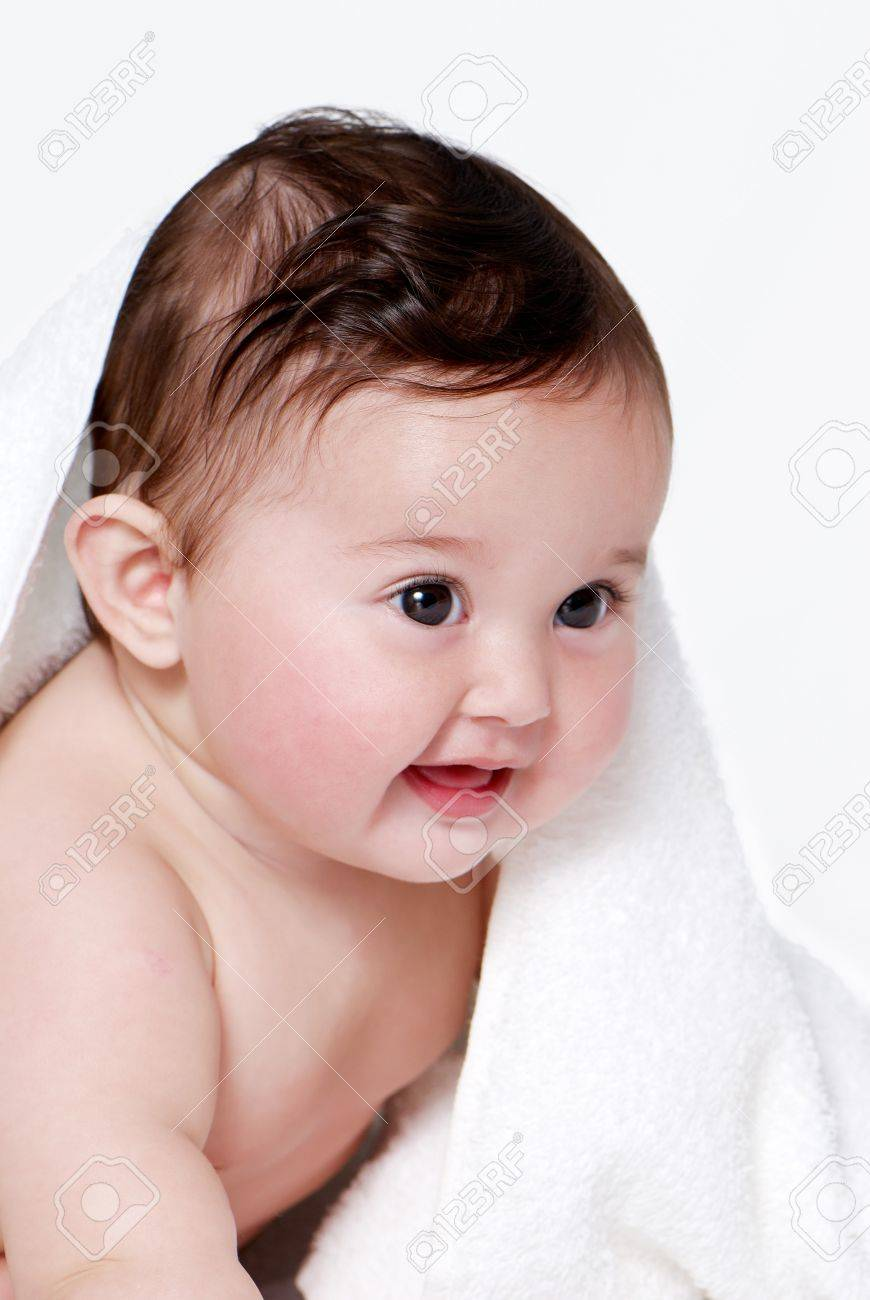 Portrait of the little baby under a terry towel Stock Photo - 7953250