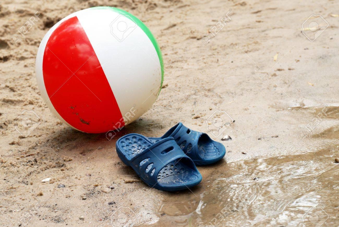 beach ball in sand.  Beach Stock Photo  Summer Slippers And Beach Ball In Sand Throughout Ball In Sand