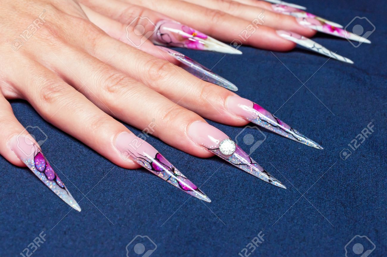 Very Long Artificial Nails At Dark Background Stock Photo, Picture ...