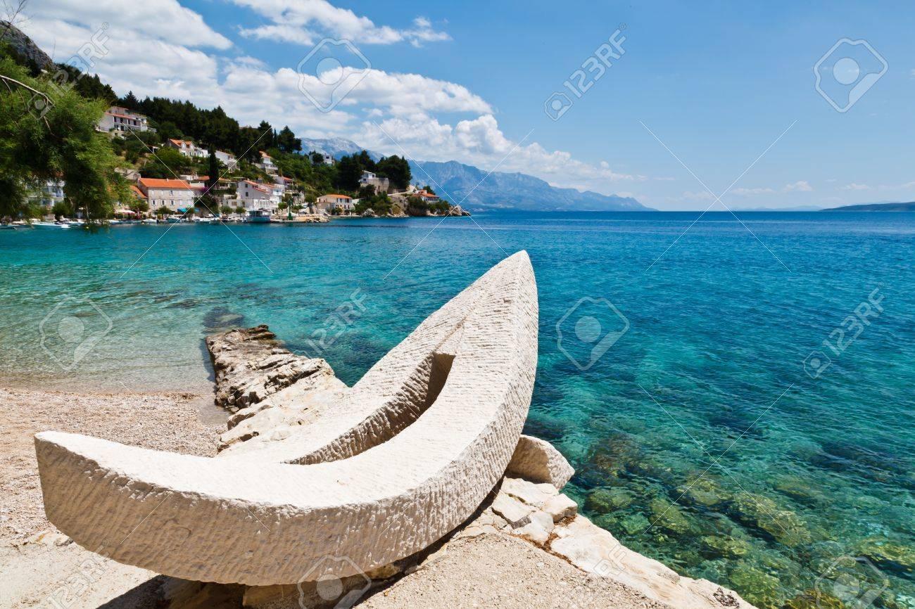 White Boat and Azure Adriatic Bay Stock Photo - 10436795
