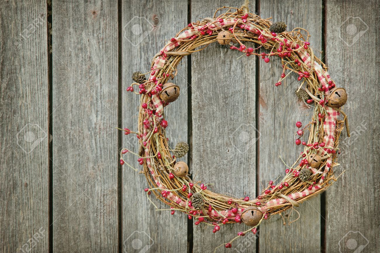 Christmas Wreath Hanging On A Wooden Rustic Vintage Background With Copy Space Stock Photo