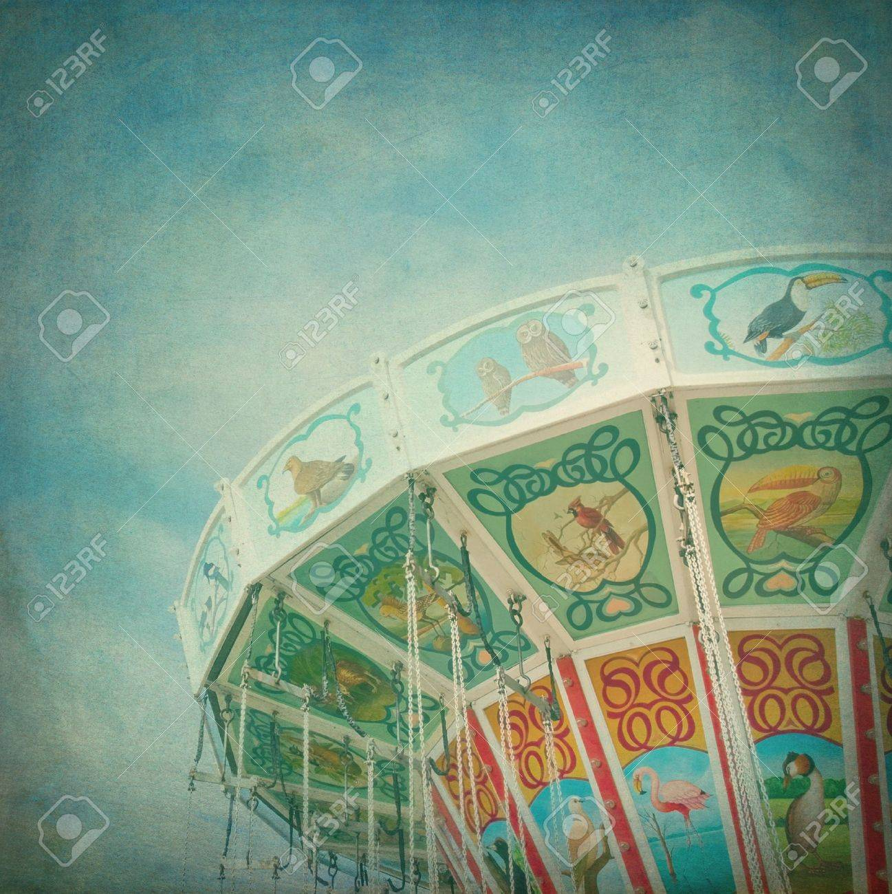 Closeup of a colorful carousel with blue sky background, with