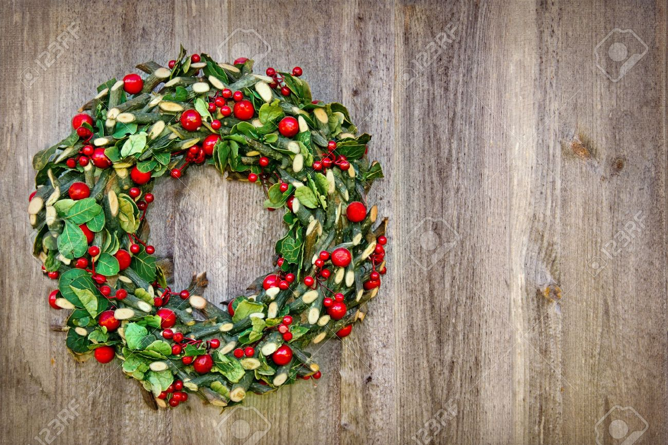 Rustic Christmas Wreath Hanging On A Wooden Vintage Background With Copy Space Stock Photo