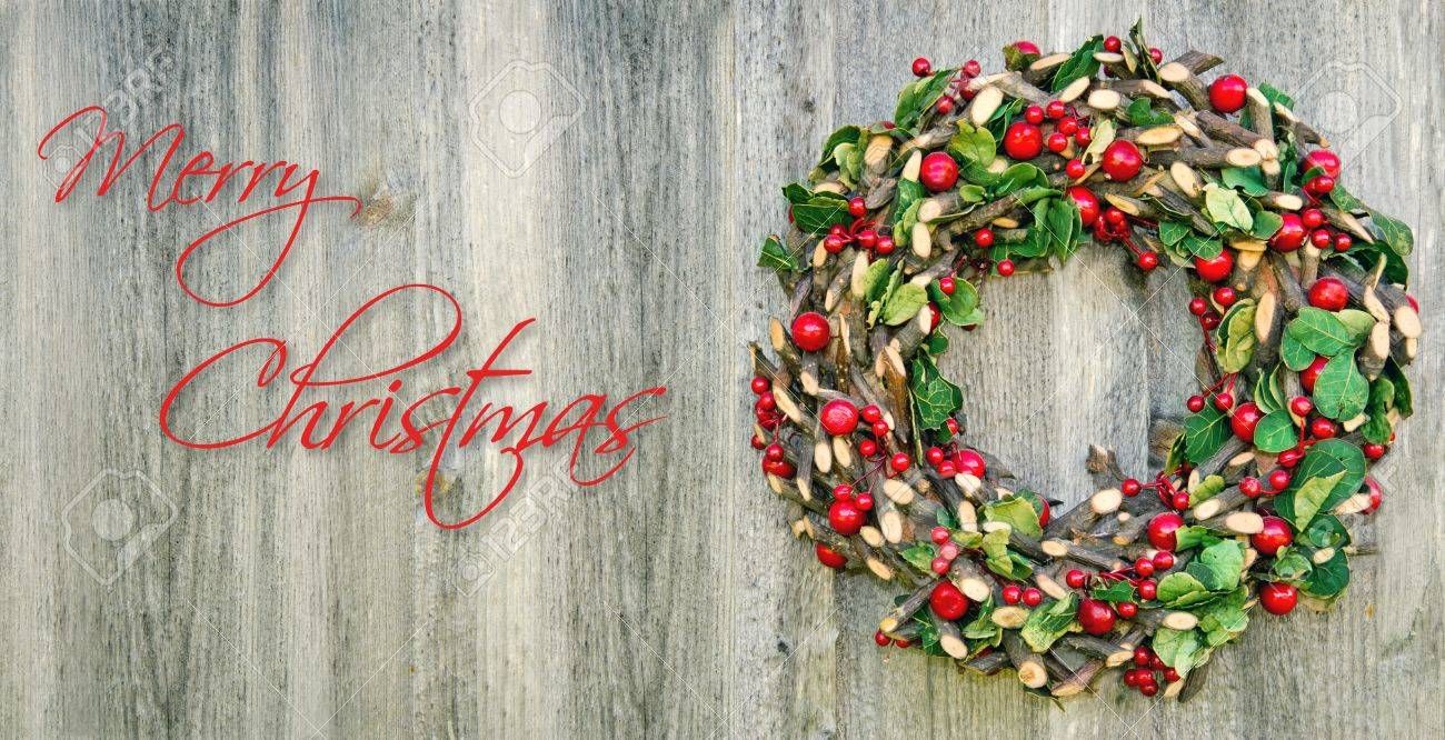 Rustic Christmas Wreath Hanging On A Wooden Vintage Background With Copy Space Text OMerry ChristmasO