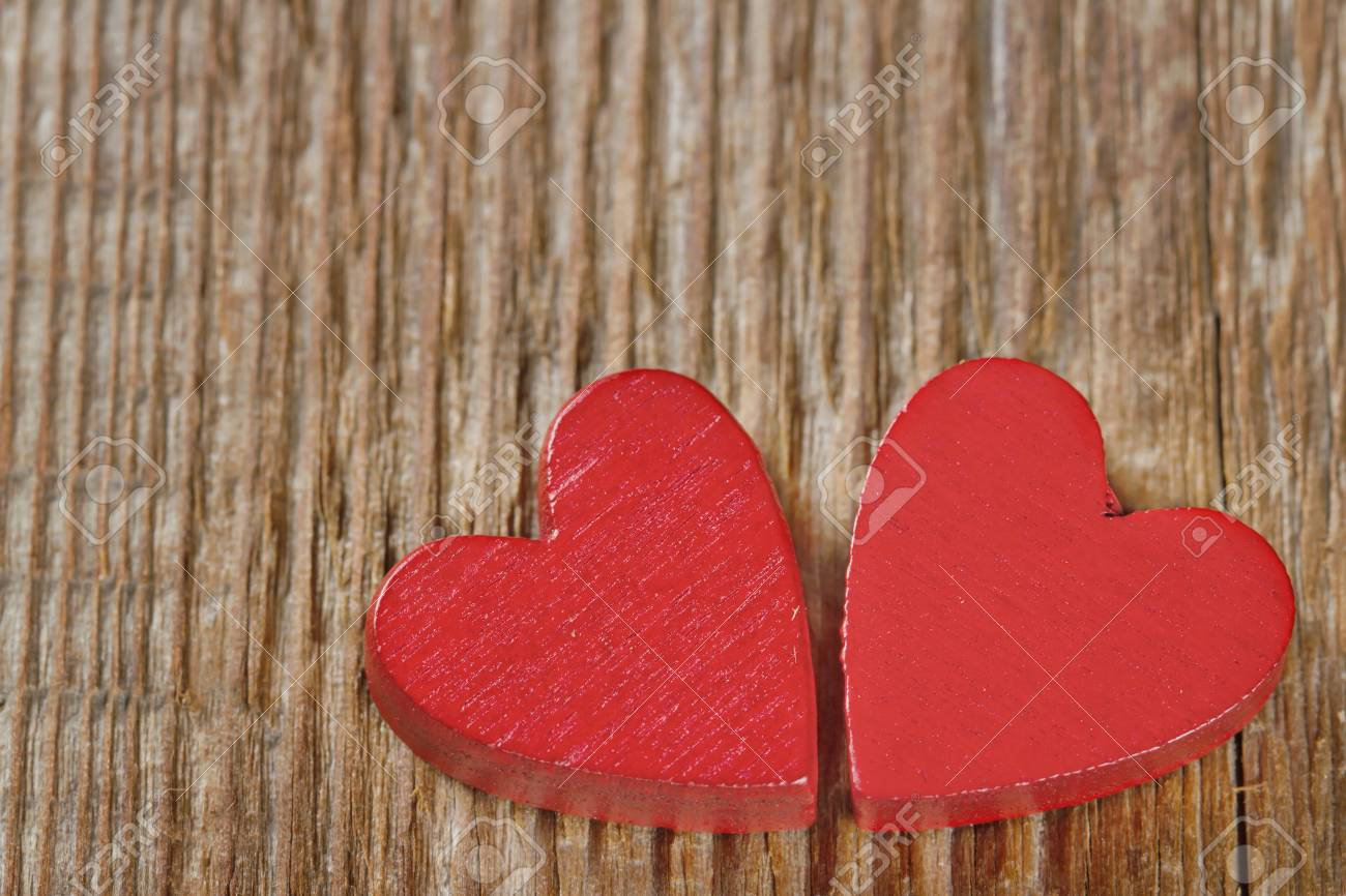Two red hearts on rustic wooden background with copy space Stock Photo - 16761412