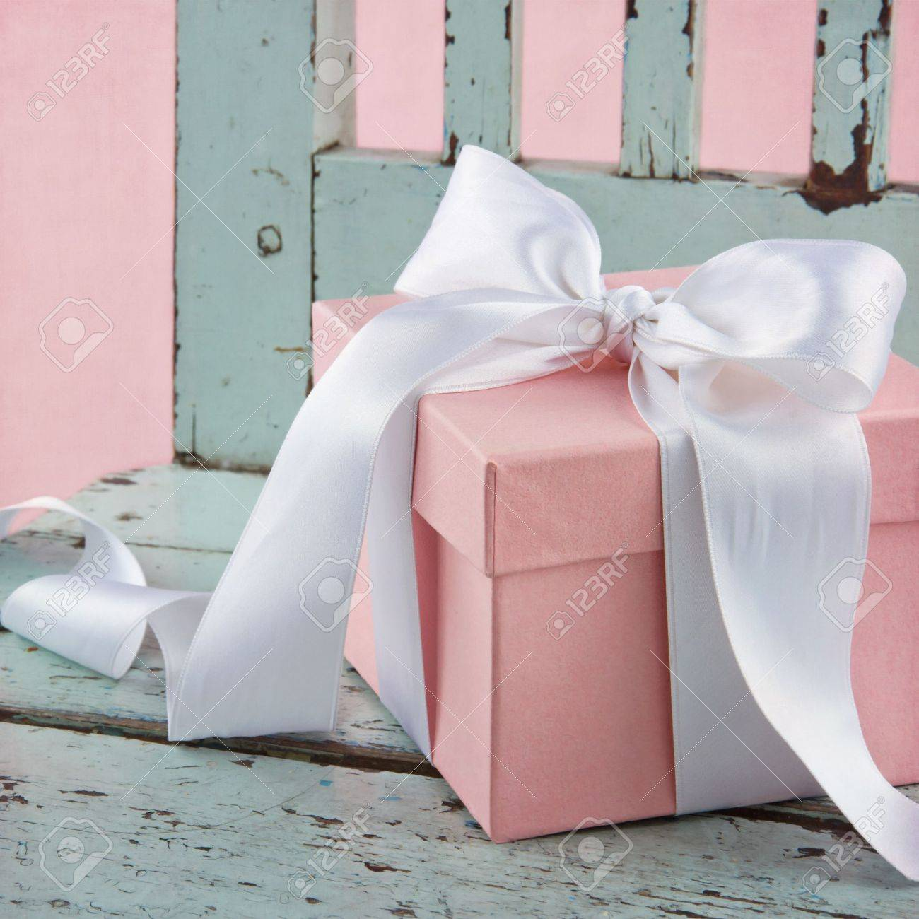 Pink Romantic Gift Box With White Satin Bow On A Light Blue Wooden ...