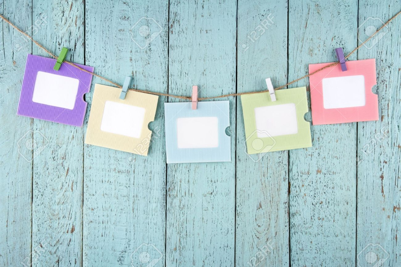 Five empty colorful photo frames or notes paper hanging with clothespins on wooden blue vintage shabby chic background Stock Photo - 19264453