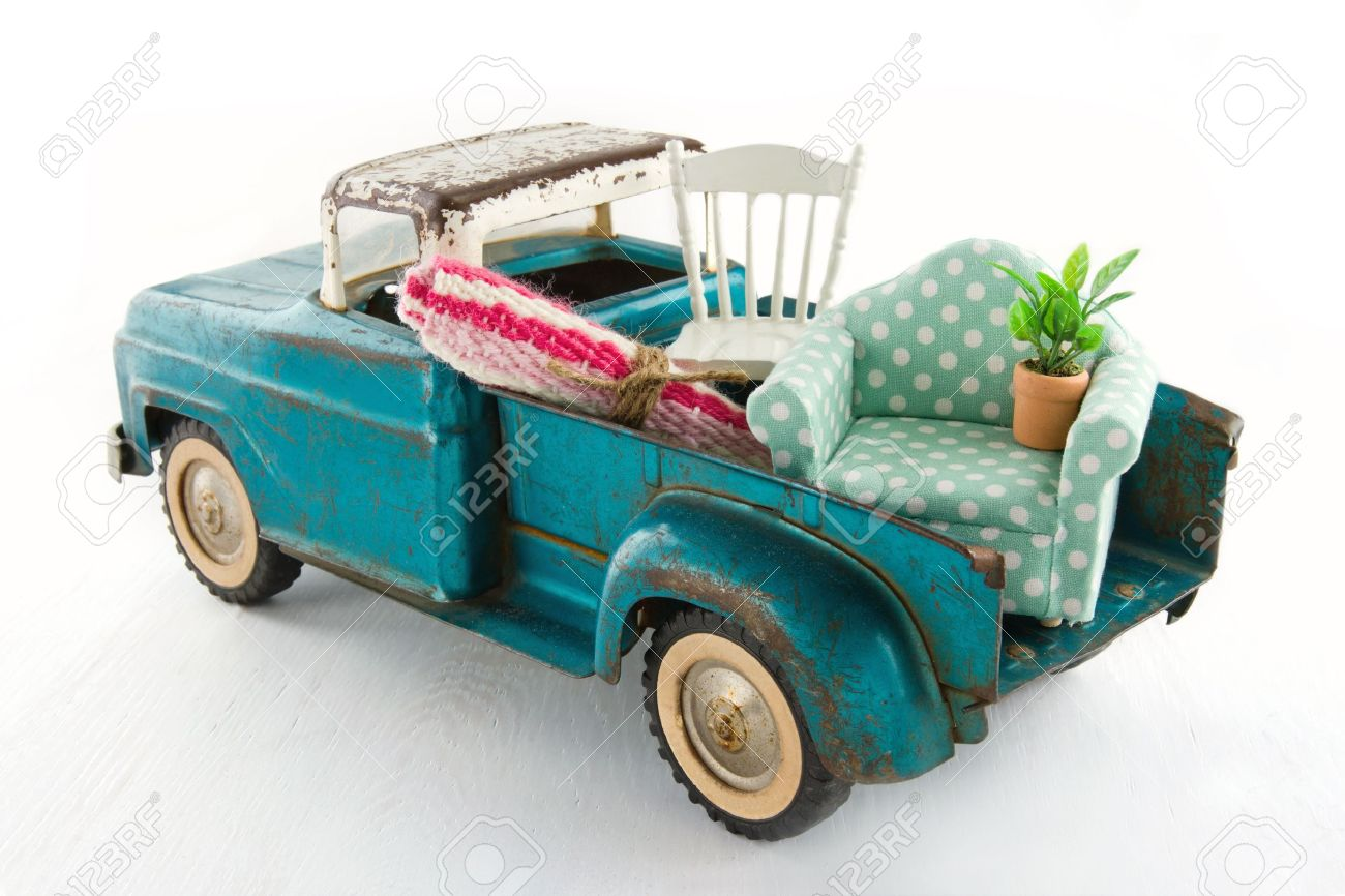 Old vintage toy truck packed with furniture - moving houses concept Stock  Photo - 19979130 - Old Vintage Toy Truck Packed With Furniture - Moving Houses Concept