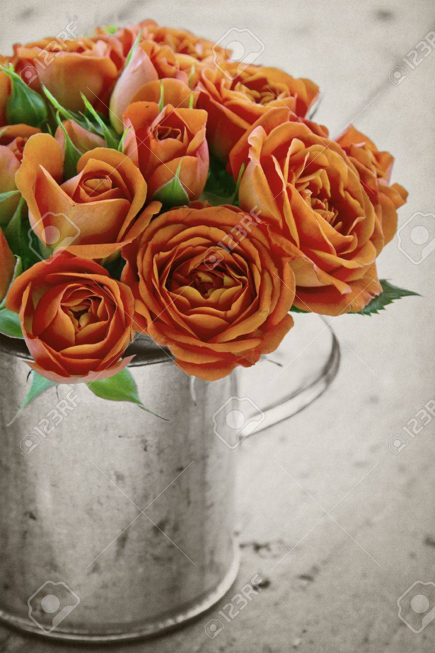 Vintage bouquet of orange roses on black and white rustic textured background Stock Photo - 19979209