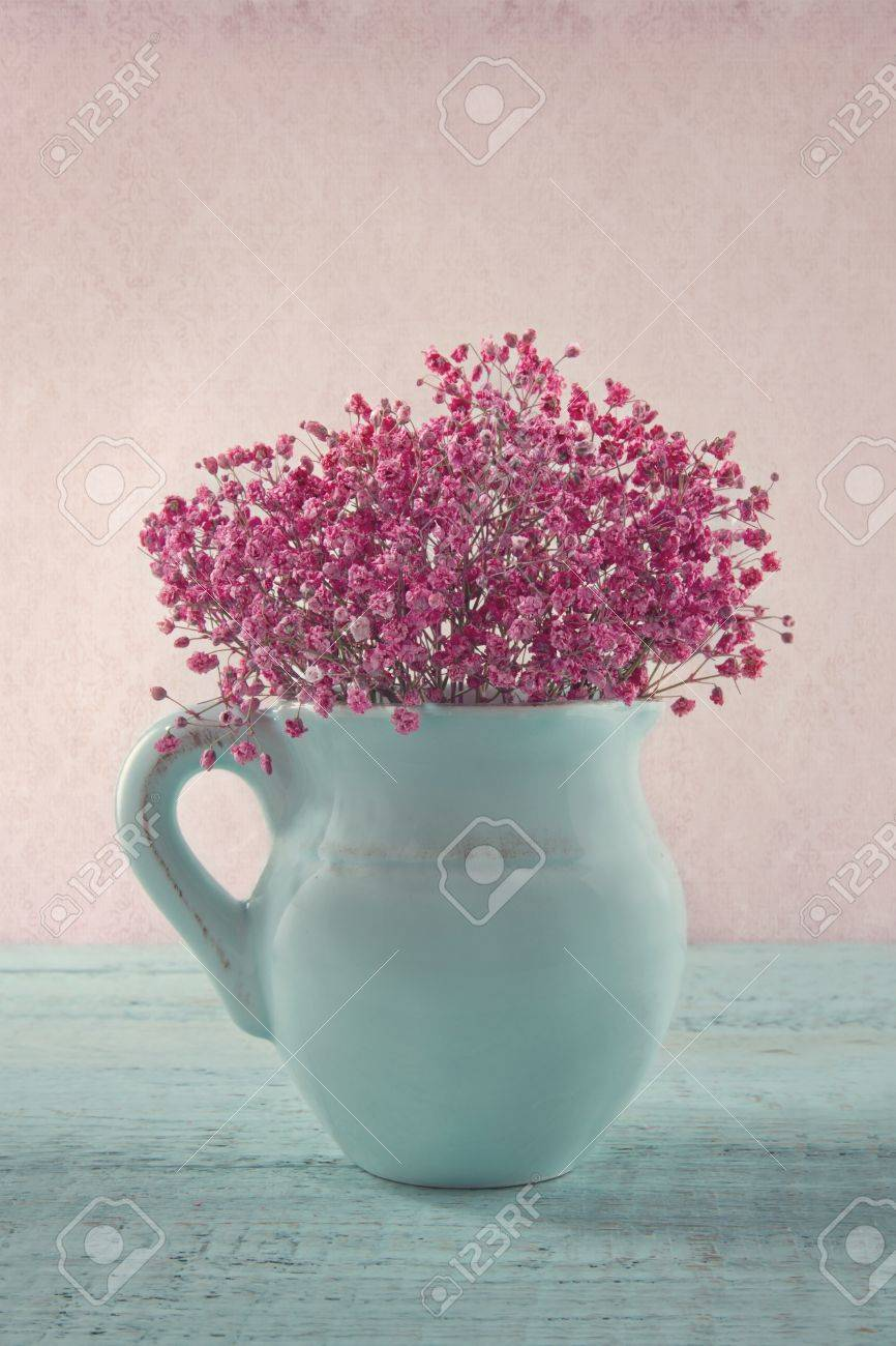 Pink Dried Baby S Breath Flowers In A Blue Jug On Wooden Background Stock Photo Picture And Royalty Free Image Image 20214345